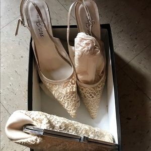 Beige Lace Dress shows low heel with purse